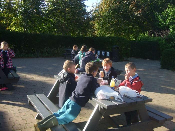We enjoyed eating our snack at the picnic tables .