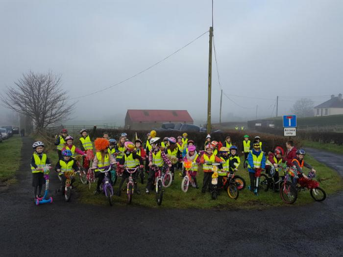 All ready for our cycle up the hill to school.